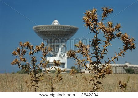 Radioactive waste and pollution - Satellite dish on dry field environmental concept