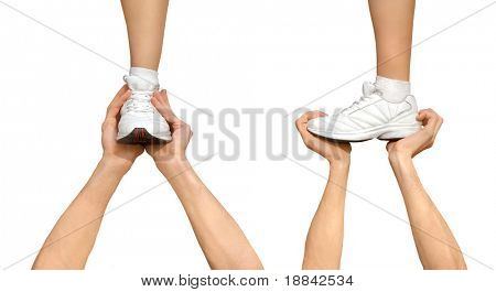 Two strong male hands holding one female foot. Teamwork, support, competition concept. Isolated on white background