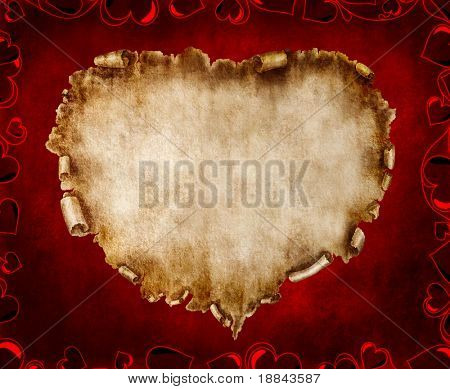 Heart-shaped vintage piece of parchment. Valentines Day Card romantic love letter on red background.