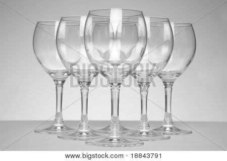 Still-life with empty glasses over white background