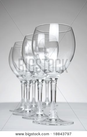 Still-life with empty glasses over white background_3