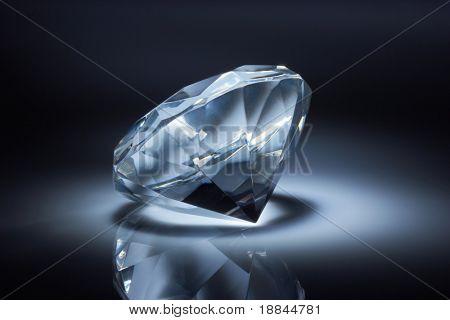 Diamond jewel on dark blue background