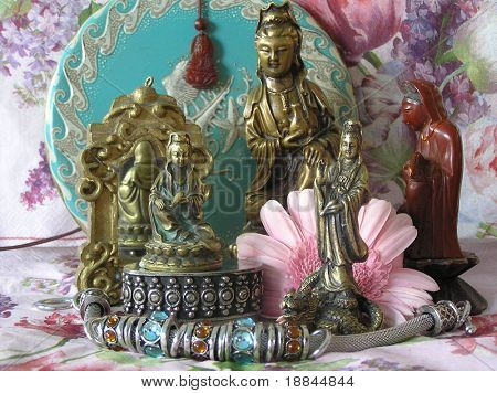 photograph of a Kwan yin collection. kwan yin is the female equivalent of buddha