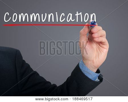 Businessman Hand Writing Communication Concept - Grey - Stock Photo