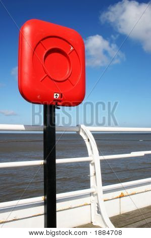 Red Lifebelt On Pier