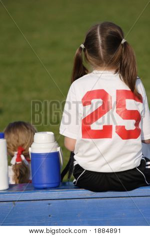 Girl On Bench At Soccer Game
