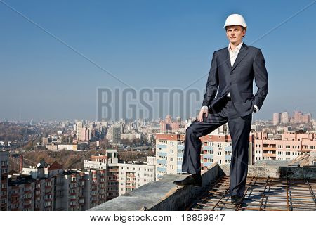 worker-builder with a helmet on a roof