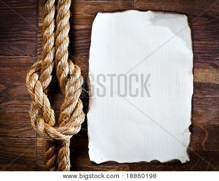 Image of old texture of wooden boards with ship rope.