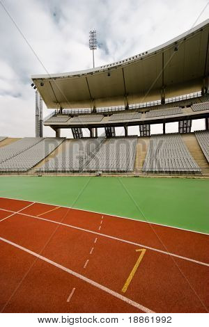 Running Tracks And The Bleachers In A Big Empty Stadium