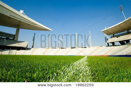 Empty Olympic Stadium Shot From Dividing Line Of The Green Grass Soccer Field