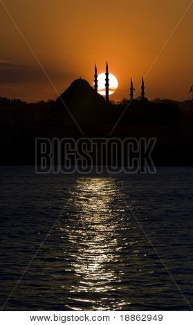 Suleymanie Mosque and the sunset from the Bosphorus in Istanbul Turkey