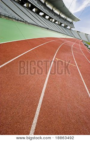 Running tracks at an empty stadium with a tilted horizon