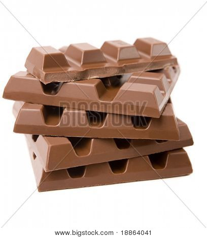 Stack of milk chocolate bars isolated on white