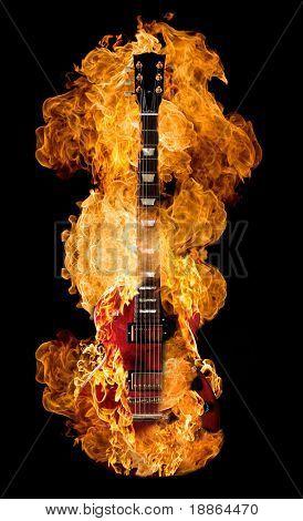 Burning electric guitar on black background