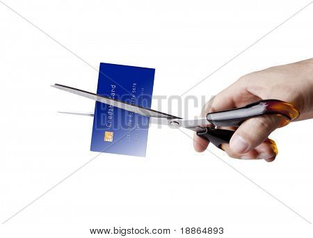 Cutting up credit card with scissors on white
