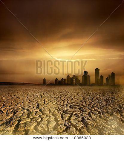 Tema poluição e o aquecimento global com a terra rachada e a paisagem urbana