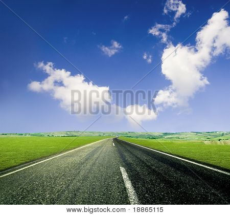 Road ahead, blue sky and countryside
