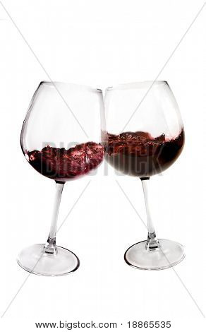 Two glasses of red wine toasting on white background