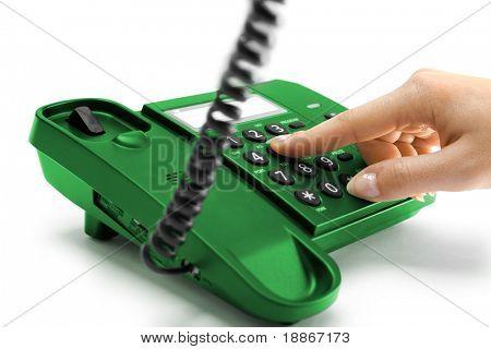 One hand pressing key on green phone
