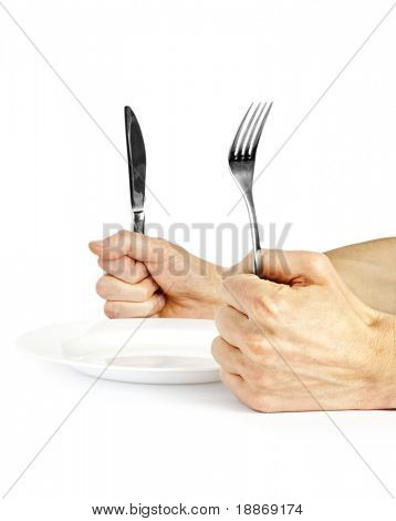 Plug and knife in hands on white background with plate