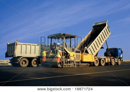 Asphalt spreader in work