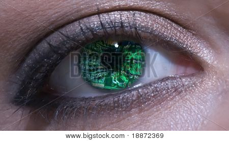 Eye of woman overlaid with circuit board pattern