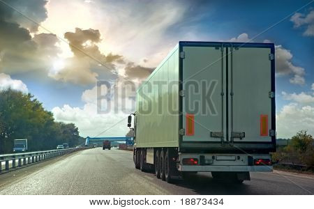 The truck on asphalt road