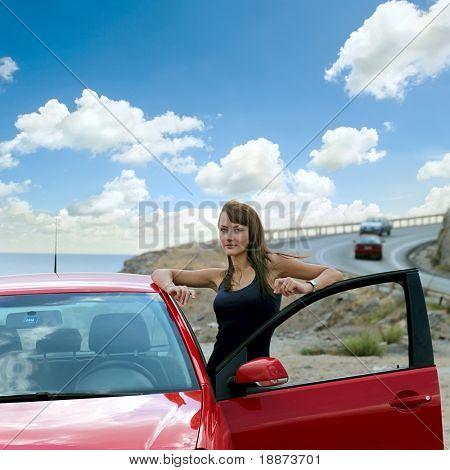 beautiful girl next door with a red car.