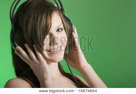 attractive teenage girl wearing headphones