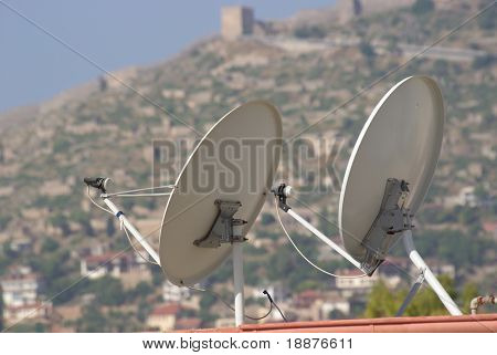 Satellite dish on the roof of a house with clipping paths
