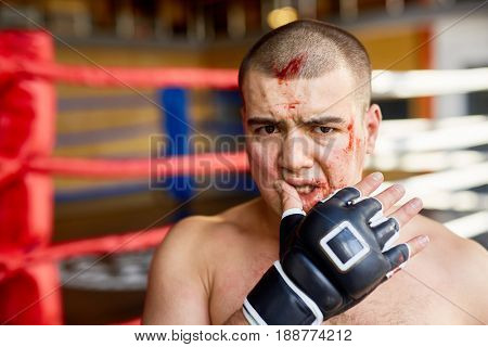 Defeated fighter with blood on