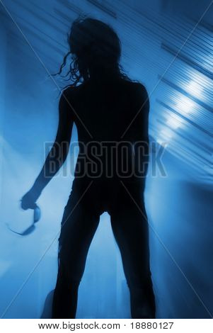 silhouette of standing disco dancer