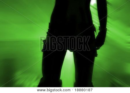 silhouette of part of dancer's body in green light
