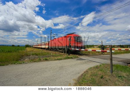 Train Passing Through A Railway Crossing.