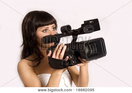 pretty girl holding HDV camcorder isolated on white