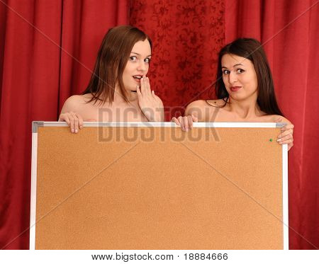 two girls hold blank board. empty area may be use for your info.
