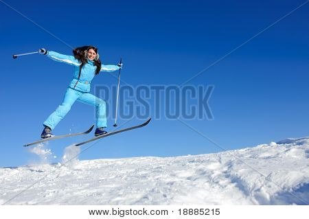 jump of happy young skier