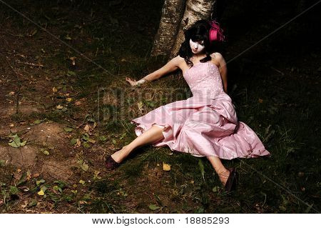 pretty teen alone in the forest, may be use for sad, halloween or dead concept