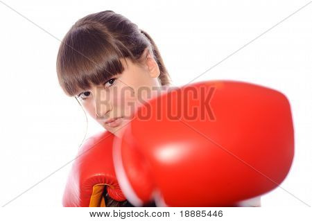 Close-up portrait of woman female boxer with red gloves, isolated on white