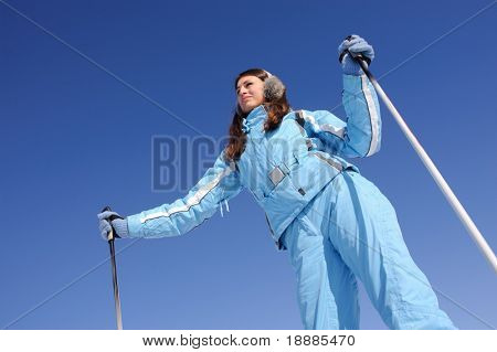 beauty woman ready for to ski down a mountain slope