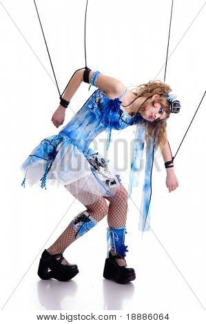 young woman in blue dress like a marionette, isolated on white