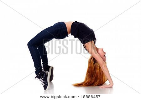agile funky young woman on tiptoe isolated on white