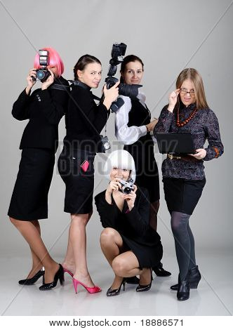 Five businesswomen with different gadgets