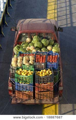 View over truck transporting fruits and vegetables with boxes