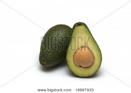 two fresh avocado on white background