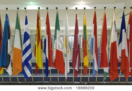 Flags of different countries in a row in the hall