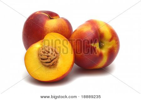 three nectarines on white background