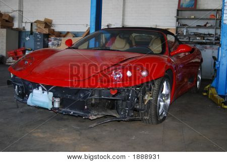 Red Ferrari Damaged At Repair Shop