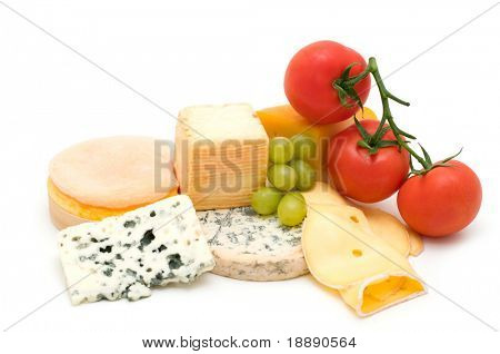 cheese assortment and vegetables on white background
