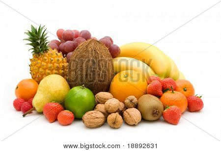 fresh fruits and nuts on white background